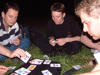 Playing cards in the park at night
